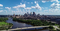 Minneapolis Skyline - Aerial Hyperlapse (Gian Lorenzo) Tags: panorama sky landscape nature travel tourism blue landmark city view panoramic clouds architecture scenic river building green park skyline usa america outdoors water minneapolis establishing establishingshot business financialdistrict timelapse hyperlapse timelapseclouds aerialview cityscape citylife citycenter mississippiriver movingclouds background sunnyday sunnyweather minnesota nopeople wideanglelens contemporary day afternoon exterior summer