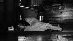 not all get to enjoy the festival (byronv2) Tags: edinburgh edimbourg scotland newtown westend princesstreet blackandwhite blackwhite bw monochrome street candid peoplewatching homeless roughsleeper sleepingbag sleeping pavement wet rain mist night edinburghbynight nuit nacht