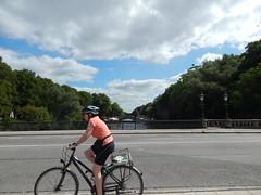 Biker on the bridge going over the Alster (Pwern2) Tags: biker biking radfahren sport road bike hamburg hansestadt tree green water alster