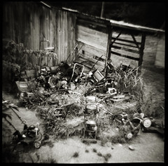 Jeff's Small Engine Repair Nº 2 (efo) Tags: bw film dianaf lawnmowers abandoned broken smallengine