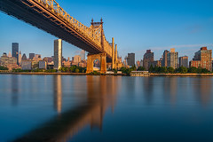Sun Soaked (Amar Raavi) Tags: edkochqueensborobridge queensborobridge eastriver longexposure sunrise reflection waterfront water cantileverbridge bridge cityscape skyline skyscrapers buildings architecture urban outdoors city 59thstreetbridge longislandcity queens manhattan uppereastside midtown newyorkcity newyork ny usa bluesky unitedstates us