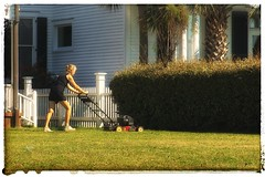 A WOMAN'S WORK IS NEVER DONE (NC Cigany) Tags: 5star grass homes lawn lawnmower palmtrees woman beaufort nc