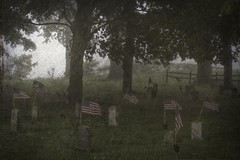 Heroes After the Storm (delmarvajim) Tags: digitalart digitalprocessing digitaleffects fineart cemetery flags heroes trees fog storm fence drama texture