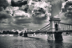 Chain Bridge (Russ Dixon Photography) Tags: hungary budapest europe bridge city architecture danube river landmark capital travel hungarian building urban famous old road buda historic european heritage pest historical cloud chainbridge history russdixon russdixonphotography monochrome mono bw blackandwhite