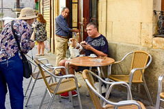 Making new friends in Salamanca, Spain (Marian Pollock) Tags: buspeople salamanca spain dog people table chairs man street europe friends befriending focus restaurant eyetoeye