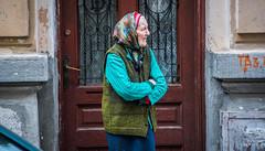2018 - Romania - Bucharest - Waiting (Ted's photos - For Me & You) Tags: 2018 bucharest cropped nikon nikond750 nikonfx romania tedmcgrath tedsphotos vignetting bucuresti bucurestiromania bucharestromania woman lady scarf sweater doorway door streetscene street profile red redrule