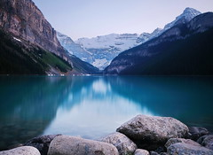 Lake Louise at dawn (sheing.coe) Tags: nature rocky mountains canada alberta lakelouise reflection landscape water serene lake mountainside mountain rock