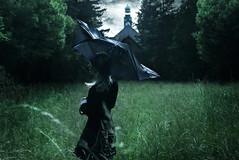 Rainy Days (Claudia Hantschel) Tags: woman girl green grass nature field fairytale mystic magical claudiahantschelphotography claudia hantschel photography portrait fineart umbrella rainy day clouds cloudy wonderland trees morbid dark art house clock
