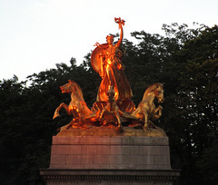 Orange Sunset Victory Statue - USS Maine Monument 4231A (Brechtbug) Tags: orange sunset victory statue maine monument 1914 beaux arts commemorating sinking battleship 1898 sculpted representations mythological figures peace courage fortitude justice central park entrance nyc 06252018 new york city statues group sculpture sculptures art golden gold leaf woman horses hippocampus seahorse hippocamp sea horse giant clam shell sled coach chariot mythology columbus circle architect h van buren magonigle sculptor attilio piccirilli 1901 1913
