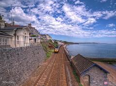 Train Approaching Dawlish (Explored) (Ian Gedge) Tags: england uk britain devon sea seaside coast coastline sky dawlish train tracks railway