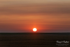 August 12, 2018 - Smoke from California and Canada colors the sunrise. (Tony's Takes)