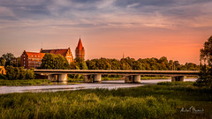 Sunset over Malbork (Michał Banach) Tags: city malbork nogat poland polska bricks bridge cityscape colors evening landscape neogotic redbrick river riverbank roadbridge sky sunset trees watertower pomorskie pl tower architecture canoneos5dmarkiv tamronsp2470mmf28divcusdg2