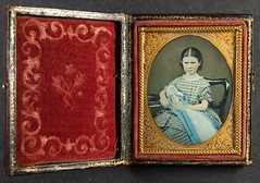 Ninth plate hand tinted ambrotype of a young girl and her doll, ca 1860 (whatsthatpicture) Tags: tinted girl doll ambrotype case ninthplate