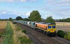 Genesee and Wyoming newly Branded for Freightliner 66413 works 6V08 Tunstead to Brentford at Langham Jn (Iain Wright Photography) Tags: genesee wyoming freightliner repainted crewe lnwr fl geneseewyoming gw class66 66413 6v08 tunstead peak district aggregates days terminal southall brentford tc hia hoppers 369s rutland langham junction nikon pole aerial photography nikond7200 harris poletop d7200 nikon7200 orange black sky moody weather tarmac stone roadstone rt
