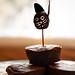 Vintage Halloween Cake Topper on Stack of Mini Brownies
