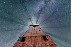 Pillar of Light (Aaron Springer) Tags: michigan northernmichigan frankfortlighthouse stars milkyway fog mist haze lighthouse summer nightsky outdoor nightphotography