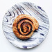 Top view of cinnamon roll in a colorful plate. White background.jpg