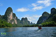 Bamboo-rafting along the Li River (China) (|kris|) Tags: asia china river blue karst hills mountains clouds liriver guilin yangshuo xingping bamboo sky landscape cruise raft tourist
