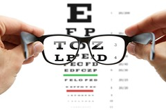 Eye exam (mghresearchinstitute) Tags: alphabet astigmatism blind care chart check correct doctor equipment exam examination eye eyechart eyeglasses eyesight eyewear focus frames glass glasses health healthcare lenses letter looking medical medicine myopia optical optics optometrist optometry patient reading seeing selective sight spectacles test text view vision visual white hands holding loupe magnifying specs watch