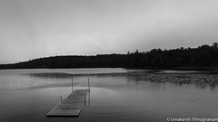 Dock (B&W) (umakantht) Tags: lake water waterfront clouds sky dock bw blackandwhite blackwhite trees lakeleslie canada que