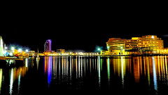I couldn't resist; one more from the harbor (Fnikos) Tags: port puerto porto harbour harbor sea water waterfront sky skyline architecture building tower bridge people light reflection night nightview nightshot outdoor
