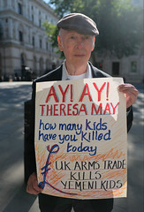 Theresa May - how many children have you killed today ? (alisdare1) Tags: yemen warcrimes theresamay protest demonstration saudiarabia uae emirates children hodeidah bombing britain london placard armstrade