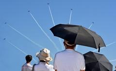 Plane Burst (Christie : Colour & Light Collection) Tags: airshow umbrellas plane stunts spectators jets airplanes aerobatic stuntplanes airport repost outdoors upwards sky bluesky