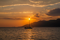 August sunset (Vagelis Pikoulas) Tags: sunset sun porto germeno greece landscape sea seascape sky clouds cloudy cloud view boat yacht august summer 2018 tamron 70200mm vc canon 6d