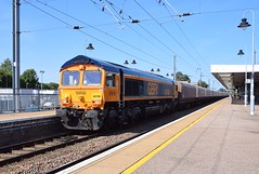 Fresh from the Paint Shop, GBRf 66788 passes slowly through Ely Station, with the Ely Papworth to Peak Forest Cemex, with a long rake of now empty stone hopper. 01 08 2018 (pnb511) Tags: loco locomotive engine diesel train class66 gbrf westangliamainline aggregates