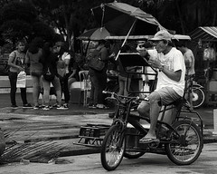 Got Mine (Beegee49) Tags: street pedicab rider driver eating snack public transport silay city philippines