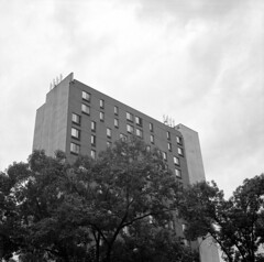 untitled (kaumpphoto) Tags: rolleiflex ilford 120 tlr bw black white building tree trees urban city street brick window sky clouds ominous tower cell leaves structure windows minneapolis