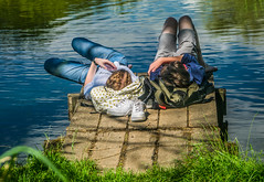 ʎǝuoH..... (+Pattycake+) Tags: grass ʎǝuoh slogan ueabroad eastanglia broad shorts trainers honey lake mirrorless red blue lumixdmcgm1 wood rucksack teeshirt relaxing lakeside chilled green jeans 43 norfolk uea season summer couple sunlight water light people street candid