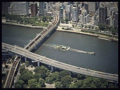 Upstream (MElfver) Tags: olympusomdem10ii panasoniclumix35100456 japan tokyo tokyoskytree sumidariver railwaybridge view fromabove barge