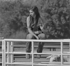 Stop the Bull (clarkcg photography) Tags: woman female brunette water waterbottle boots corral arena fence onthefence stopthebull bull horns blackandwhite blackwhite bw portrait hair twist