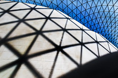 On the grid (Maerten Prins) Tags: england engeland brittain london londen britishmuseum museum foster greatcourt roof steel glass triangles lines curves transparant geometry geometric upshot up above sky symmetry architecture wall shadow grid blue