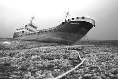 Hephaestus (Rob McC) Tags: bw black white malta monochrome hephaestus maritime ship boat rocks sea waterfront cargo run aground shipwreck
