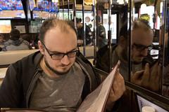 Seanie in Philadelphia (dckellyphoto) Tags: philadelphia pennsylvania 2018 philadelphiapa philly man male portrait menu petesfamouspizza restaurant mirror