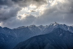 Bhutan: Dance upon the Mountains like a Flame. (icarium.imagery) Tags: bhutan blue canoneos5dmarkiv captureone cinematic colortint dramaticsky drukyul himalayas hills landscape mountainrange mountains mysterious mystical nature paro peaks pristine travel valley snowcapped