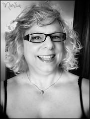 Smile (Monica E Lopez) Tags: androgyny androgynous sissy tg ts tv tgirl trans transexual transgender transsexual transvestite genderbender gurl m2f mtf feminization crossdress crossdresser femme feminine feminized hrt hormones passable smile glasses monotone blackwhite