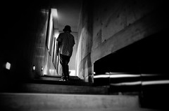 Approached... (明遊快) Tags: dark contrast lights shadows stairs hat man monochrome architecture