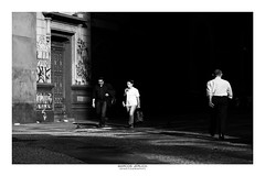 [ Between light and darkness ] (Marcos Jerlich) Tags: streetart street urban life light darkness contrast people walking facade architecture downtown sunlight flickr 7dwf bnw blancoynegro bw noiretblanc monochrome mono saopaulo brasil américadosul canon canont5i canon700d efs1855mm marcosjerlich