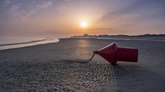 Waiting for the tide.. (aantwaarpe) Tags: buoy beach sea sunrise arrow tide red strand zee oostduinkerke belgium boei ketting chain object challengegamewinner