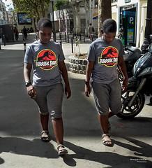 Street - Prehistoric twins (François Escriva) Tags: street streetphotography paris france fun funny candid brothers boys twins teens samsung jurassic park tsirt sun light photo rue colors red grey yellow walking
