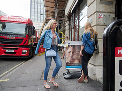 Great Castle Street. 20180815T12-50-53Z (fitzrovialitter) Tags: denim jeans peterfoster fitzrovialitter city camden westminster streets rubbish litter dumping flytipping trash garbage urban street environment london fitzrovia streetphotography documentary authenticstreet reportage photojournalism editorial captureone olympusem1markii mzuiko 1240mmpro microfourthirds mft m43 μ43 μft geotagged oitrack exiftool girl candid portrait streetportrait