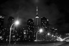 Gardiner Expressway (Gary Kinsman) Tags: gardinerexpressway fujix100t fujifilmx100t canada ontario toronto bw blackwhite car onthemove movement motion ontheroad highway landscape skyline highrise tower architecture travel journey cntower skyscraper downtown downtowntoronto highiso availablelight ambientlight 2018 lights