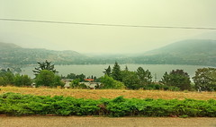 Forest fire smoke is so thick for the past week, taken through my front window in Coldstream BC (Out-of-Doors Photos in Coldstream B.C.) Tags: forest fire smoke coldstream bc forestfiresmoke sun okanaganvalley coldstreambc vernonbc forestfire mountain sky landscape water city tree