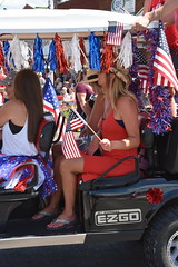 139th Annual 4th of July Parade (Adventurer Dustin Holmes) Tags: 2018 webstercounty missouri marshfieldmo marshfieldmissouri parade parades events independenceday outdoor 4thofjuly july4th annual 139th midwest aboubenadhem shriners golfcart ezgo stexpress people person female woman girl reddress americanflag usflag flags flag whitetanktop hat sandals streamers arm holding legs knees feet toes sitting strawhat cowboyhat longhair blonde brunette human patriotic patriotism