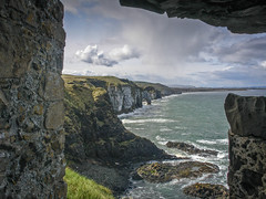 North Antrim coast vied from Dunluce castle window (jac.photography49) Tags: clouds coast cliff castle dunluce headland exposure sea shore ireland view rocks sky northernireland waves water wideangle sony