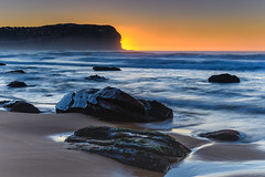 Sunrise Seascape and Headland (Merrillie) Tags: daybreak sunrise nature water clearskies cloudless bluesky macmasters centralcoast newsouthwales rocks earlymorning nsw morning sea ocean dawn waterscape landscape coastal macmastersbeach outdoors seascape australia coast sky waves