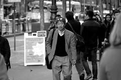 People on Market St 129 (TheseusPhoto) Tags: candid candids california sanfrancisco blancoynegro blackandwhite bnw monochrome monotone people streetphotography street man sunglasses mustache face